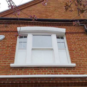 Curved Box Sash windows and fixed side lights